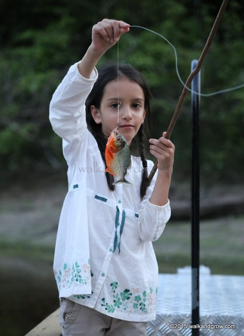 Girl holding up piranha